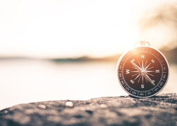 compass-of-tourists-on-mountain-at-sunset-sky-picture-id1044022268.jpg